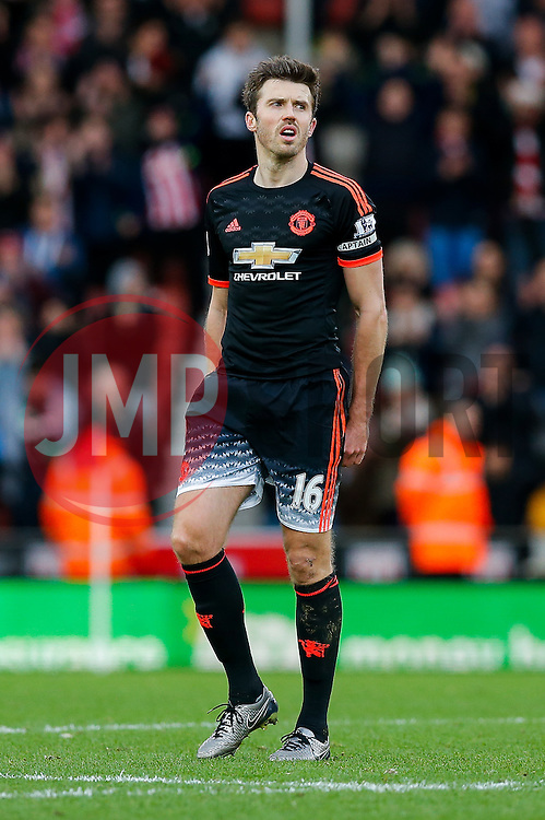 Michael Carrick of Manchester United looks dejected after Manchester United lose the game 0-2 - Mandatory byline: Rogan Thomson/JMP - 26/12/2015 - FOOTBALL - Britannia Stadium - Stoke, England - Stoke City v Manchester United - Barclays Premier League - Boxing Day Fixture.