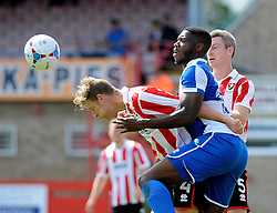 Nathan Blissett of Bristol Rovers is beaten to the ball by Kyle Storer of Cheltenham Town - Mandatory by-line: Neil Brookman/JMP - 25/07/2015 - SPORT - FOOTBALL - Cheltenham Town,England - Whaddon Road - Cheltenham Town v Bristol Rovers - Pre-Season Friendly