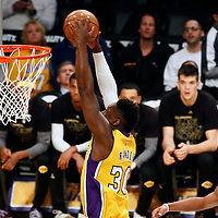 28 February 2017: Los Angeles Lakers forward Julius Randle (30) goes for the dunk past Charlotte Hornets guard Nicolas Batum (5) during the Charlotte Hornets 109-104 victory over the LA Lakers, at the Staples Center, Los Angeles, California, USA.