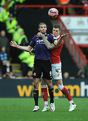 Bristol City's Aden Flint challenges for the header with West Ham's Andy Carroll - Photo mandatory by-line: Dougie Allward/JMP - Mobile: 07966 386802 - 25/01/2015 - SPORT - Football - Bristol - Ashton Gate - Bristol City v West Ham United - FA Cup Fourth Round