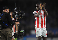 Football - 2017 / 2018 Premier League - Brighton & Hove Albion vs. Stoke City<br /> <br /> Stoke goalscorer, Kurt Zouma applauses the stoke fans after the match, at The Amex.<br /> <br /> COLORSPORT/ANDREW COWIE