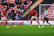 Brad Potts of Barnsley (20) passes the ball during the EFL Sky Bet League 1 match between Barnsley and Charlton Athletic at Oakwell, Barnsley, England on 29 December 2018.