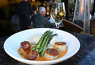 BRENDAN FITTERER  |  VISIT FLORIDA<br /> Seared sea scallops with lemon risotto, grilled asparagus and lobster cream sauce at Mattison's City Grille downtown Sarasota, 1 North Lemon Ave Sarasota, FL 34236.