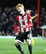 Brentford midfielder Ryan Woods celebrating Brentford scoring the winning goal during the Sky Bet Championship match between Brentford and Nottingham Forest at Griffin Park, London, England on 21 November 2015. Photo by Matthew Redman.