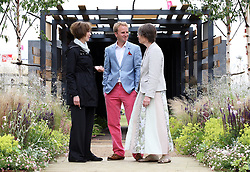 Matthew Childs, who was badly injured in the 2005 Edgware Road bombing , with the garden he has designed at  the RHS Hampton Court Palace flower show , Monday, 2nd July 2012. With Matthew are fellow survivors of the bombing Liz Owen (left) and Kathy Lazenbatt.  Photo by: Stephen Lock / i-Images