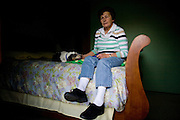 Carol Couts poses for a portrait in the bedroom of her Yuba City, California home April 6, 2009. Couts is awaiting eviction from the home she has owned for over 30 years.