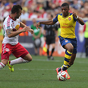 Chuba Akpom, (right), Arsenal, challenged by Armando, New York Red Bulls,  in action during the New York Red Bulls Vs Arsenal FC,  friendly football match for the New York Cup at Red Bull Arena, Harrison, New Jersey. USA. 26h July 2014. Photo Tim Clayton