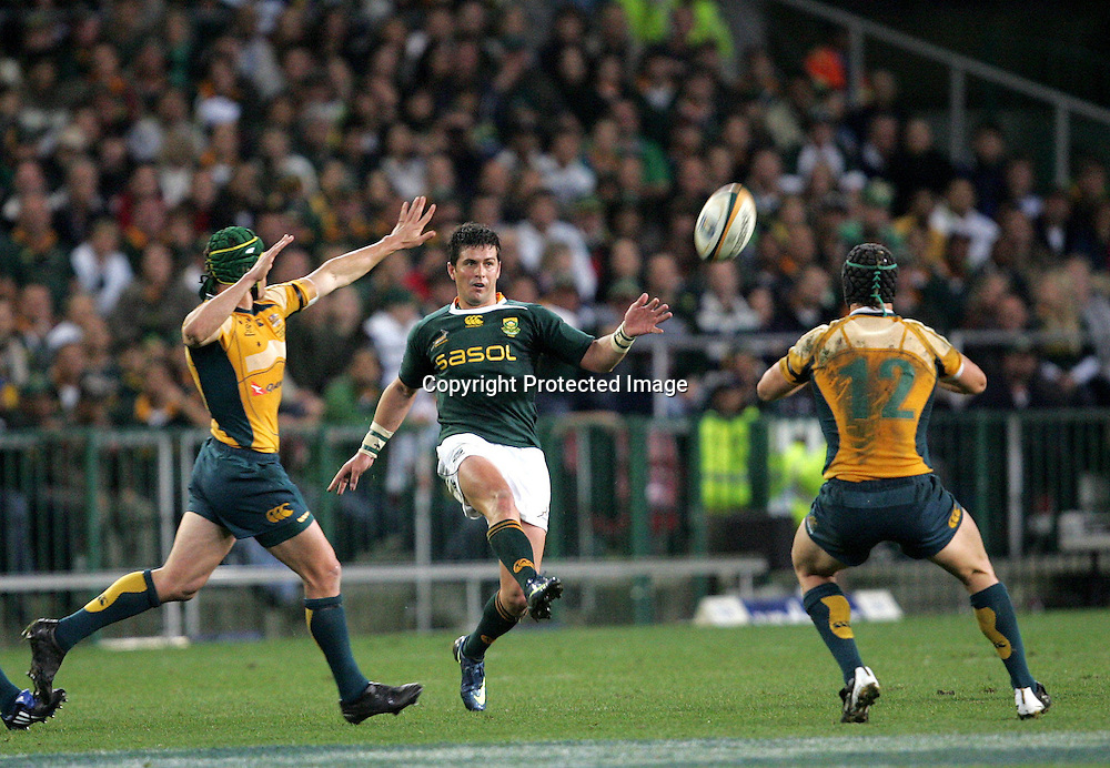 Matt Giteau and Berrick Barnes try and stop Morne Steyn during the first 2009 tri-nations test match between South Africa and Australia held on the 8 August 2009 at Newlands Stadium in Cape Town, South Africa..Photo by RG/www.sportzpics.net.+27 (0) 21 785 6814