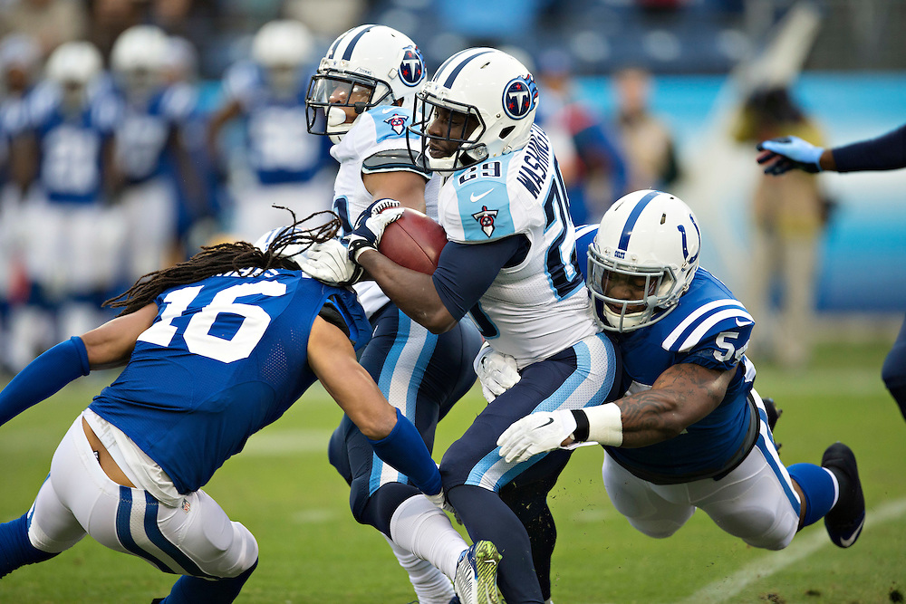 NASHVILLE, TN - DECEMBER 28:  Leon Washington #29 of the Tennessee Titans is tackled from behind by Andrew Jackson #54 of the Indianapolis Colts in the first quarter at LP Field on December 28, 2014 in Nashville, Tennessee.  The Colts defeated the Titans 27-10.  (Photo by Wesley Hitt/Getty Images) *** Local Caption *** Leon Washington; Andrew Jackson