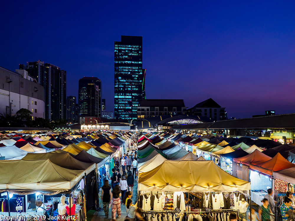 05 MARCH 2019 - BANGKOK, THAILAND:  An overview of the Ratchada Night Market. The AIA Capital Center Building is in the background. The Ratchada Night Market is the newest night market in Bangkok. It was originally a small night market popular with local people but now is tourism destination. Most nights the market is jammed with foreign tourists.   PHOTO BY JACK KURTZ