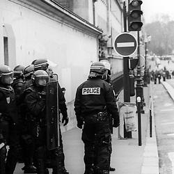 Policiers et gendarmes des Compagnies Républicaines de Sécurité (CRS) et Escadrons de Gendarmerie Mobile (EGM) les 23 mars, 4 avril et 11 avril 2006 en maintien de l'ordre lors des manifestations contre le Contrat Première Embauche (CPE) à Paris.<br /> Photos noir & blanc réalisées en Tmax400 puis numérisées<br /> Mars 2006 / Paris (75) / FRANCE<br /> Voir le reportage complet (73 photos)<br /> http://sandrachenugodefroy.photoshelter.com/gallery/2006-03-MO-manifestations-anti-CPE-Complet/G0000vFMRXkKoQ2I/C0000yuz5WpdBLSQ