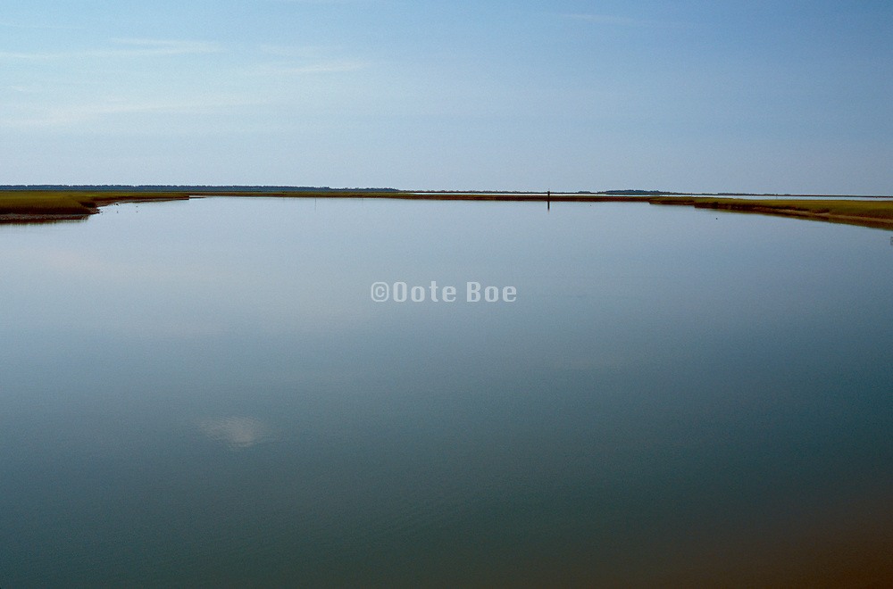 Tranquil landscape of water and sky