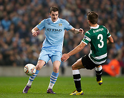 MANCHESTER, ENGLAND - Thursday, March 15, 2012: Manchester City's Adam Johnson in action against Sporting Clube de Portugal's Daniel Carrico during the UEFA Europa League Round of 16 2nd Leg match at City of Manchester Stadium. (Pic by Vegard Grott/Propaganda)