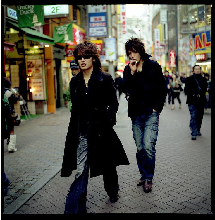 "Gal-o Boys walking up ""Sentagai"" Street, Shibuya, okyo, Japan."