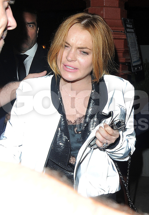 Actress Lindsay Lohan leaving the LFW AnOther Magazine party at Loulou's private members club in Mayfair, London, UK. 15/09/2014<br />