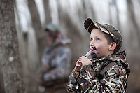 YOUNG BOY DUCK HUNTER WEARING REALTREE MAX 4 CAMOUFLAGE AND BLOWING A DUCK CALL