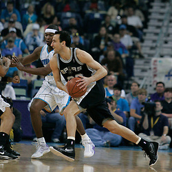 29 March 2009: San Antonio Spurs guard Manu Ginobili (20) drives past New Orleans Hornets guard Devin Brown (23) during a 90-86 victory by the New Orleans Hornets over Southwestern Division rivals the San Antonio Spurs at the New Orleans Arena in New Orleans, Louisiana.