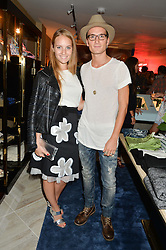 PETRA PALUMBO and OLLIE PROUDLOCK  at a party to celebrate the launch of Baar & Bass, 336 Kings Road, London on 9th September 2014.