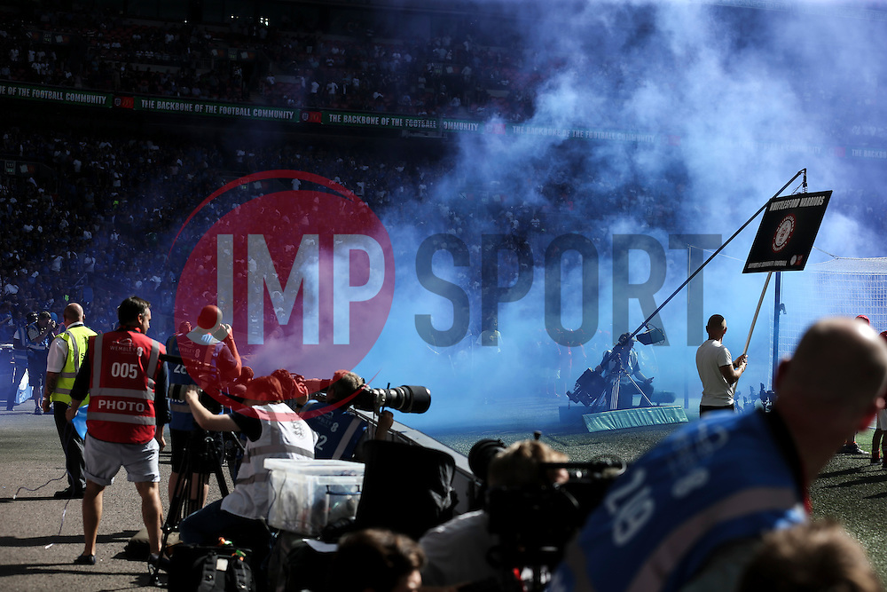 Leicester City fans throw a blue smoke bomb at the start of the match - Mandatory byline: Jason Brown/JMP - 07966386802 - 07/08/2016 - FOOTBALL - Wembley Stadium - London, England - Leicester City v Manchester United - FA Community Shield