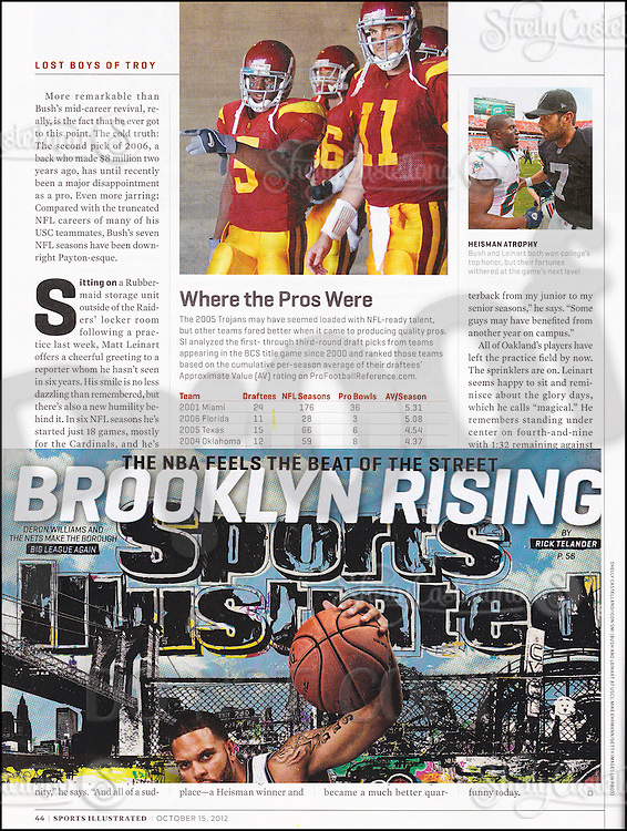 """15 October 2012:  Photo of Matt Leinart and Reggie Bush published page 44 of Sports Illustrated """"Lost Boys of Troy""""."""