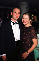 TV presenter LIZ EARLE and her fiancee MR PATRICK DRUMMOND, at a concert in London on 30th November 1999.MZO 118
