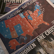 Day after the election, national and local newspaper headlines:  Trump Triumphs,  America's future, America Decides, battleground states, key states