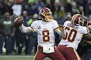 Nov 5, 2017; Seattle, WA, USA; Washington Redskins quarterback Kirk Cousins (8) throws a pass against the Seattle Seahawks during an NFL football game at CenturyLink Field. The Redskins defeated the Seahawks 17-14.