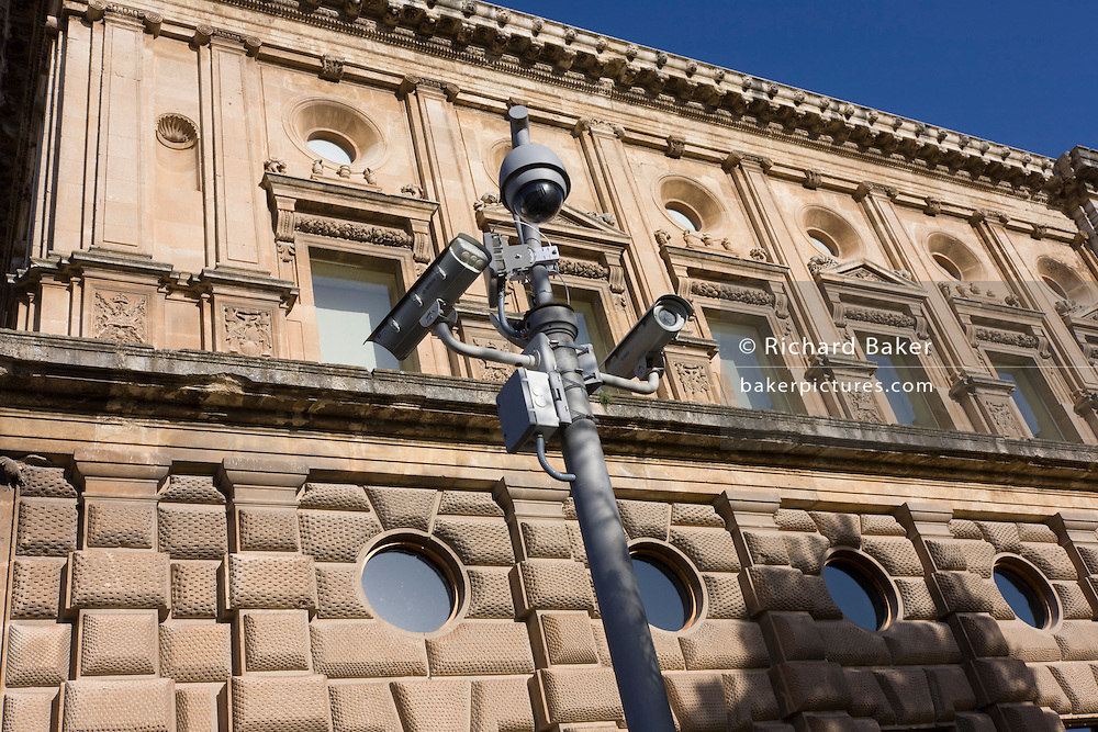CCTV security cameras mounted outside the Palacio de Carlos V at Alhambra, Granada, Spain.