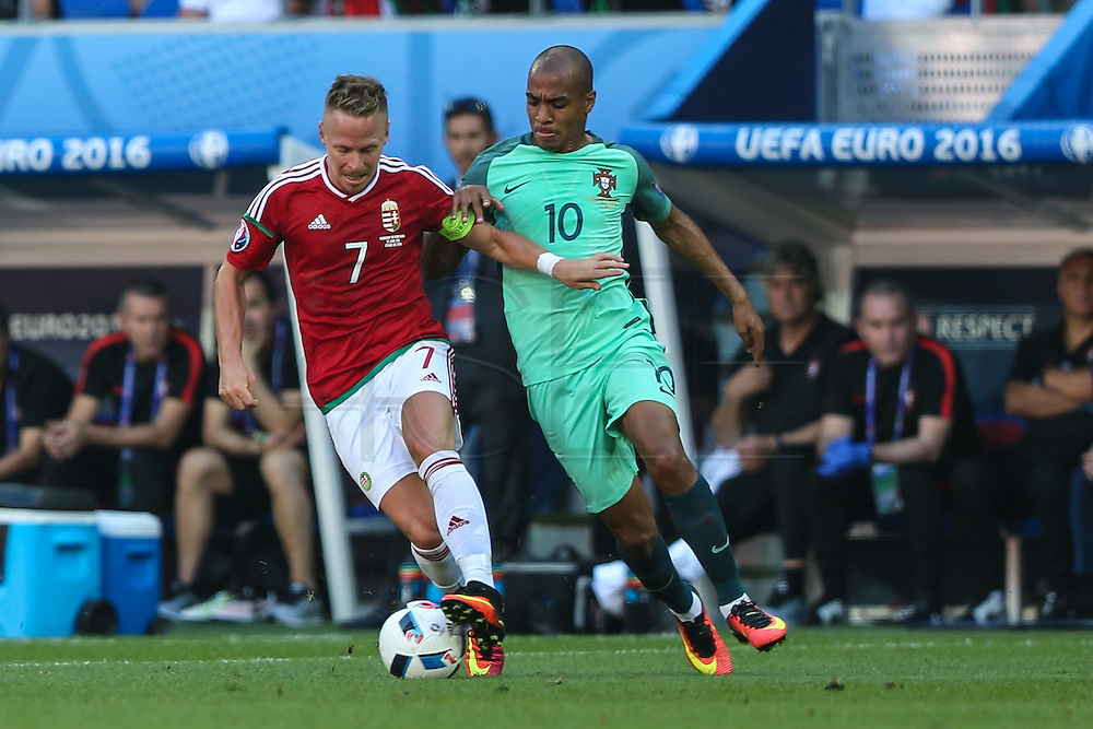 The player Hungary, Balázs Dzsudzsák and João Mário de Portugal during starting F Group of Euro 2016 in the Stade des Lumières in Lyon, France, on Wednesday.