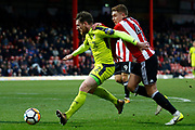 Notts County defender Matt Tootle (2) holds off Brentford Midfielder Lewis Macleod (4) during the The FA Cup 3rd round match between Brentford and Notts County at Griffin Park, London, England on 6 January 2018. Photo by Andy Walter.