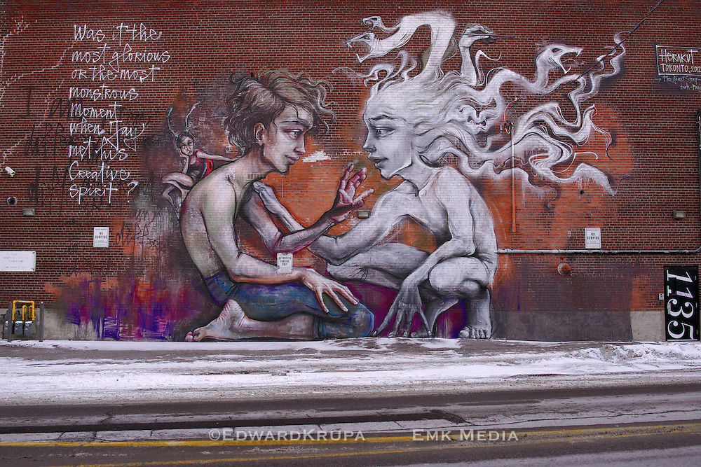 """German street art duo Herakut mural in Toronto a part of their """"A Giant Story book Project."""""""
