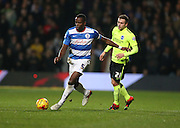 Queens Park Rangers defender Nedum Onuoha (5) goes past Brighton striker (on loan from Manchester United), James Wilson (21) during the Sky Bet Championship match between Queens Park Rangers and Brighton and Hove Albion at the Loftus Road Stadium, London, England on 15 December 2015.