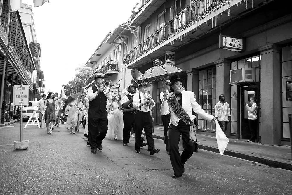 "Second line is a tradition in brass band parades in New Orleans, Louisiana. The ""main line"" or ""first line"" is the main section of the parade, or the members of the actual club with the parading permit as well as the brass band. Those who follow the band just to enjoy the music are called the ""second line."" The second line's style of traditional dance, in which participants walk and sometimes twirl a parasol or handkerchief in the air, is called ""second lining."" It has been called ""the quintessential New Orleans art form""."
