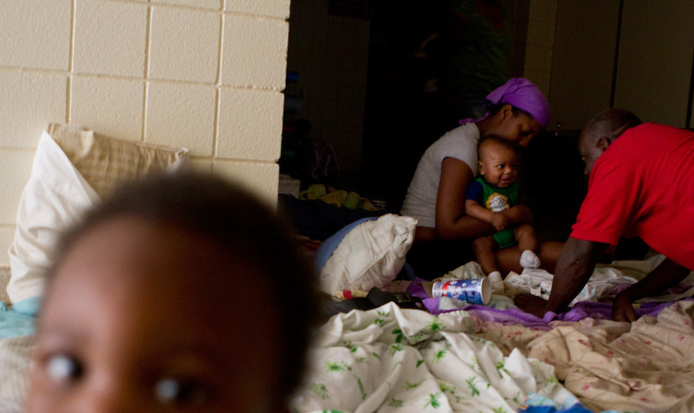 Amari Delmar, 15 months, and his family slept in the dark hallways of the Brinson Elementary School shelter, facilitated by the American Red Cross, during the wake of Hurricane Irene. The family had no information about their home in Craven County, and had been at the shelter since Friday. The shelter housed more than 100 people during the duration of the storm, without power and while sustaining water damage. ..The school is not expected to open for a few weeks, the manager said. Clean up crews will have to begin repairs once the structural repairs have been made and the power has been restored.