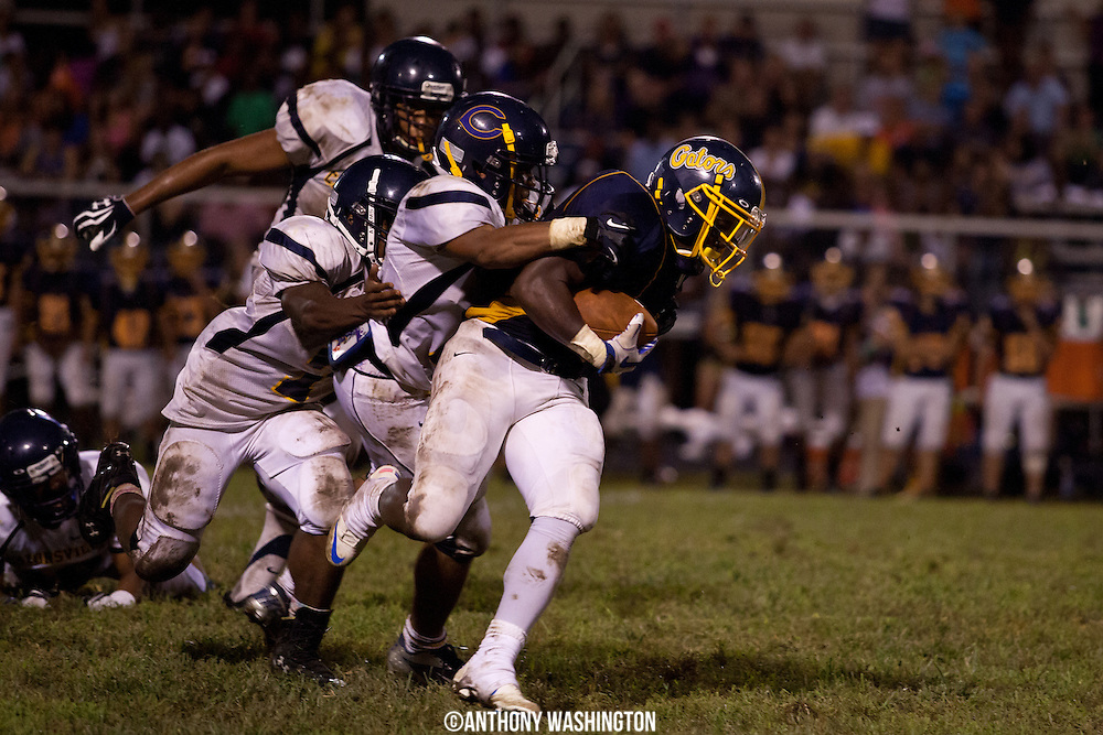 Perry Hall running back Eric Latham tries to break a tackle after a long gain against the Catonsville High School Comets on Friday, September 7, 2012 in Perry Hall, MD.