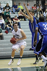 16 November 2013:  Michael Mayberger approaches the lane during an NCAA mens division 3 basketball game between the Aurora University Spartans and the Illinois Wesleyan Titans in Shirk Center, Bloomington IL