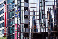 Buildings reflected in the glass facades of other buildings in downtown Tokyo, Japan.
