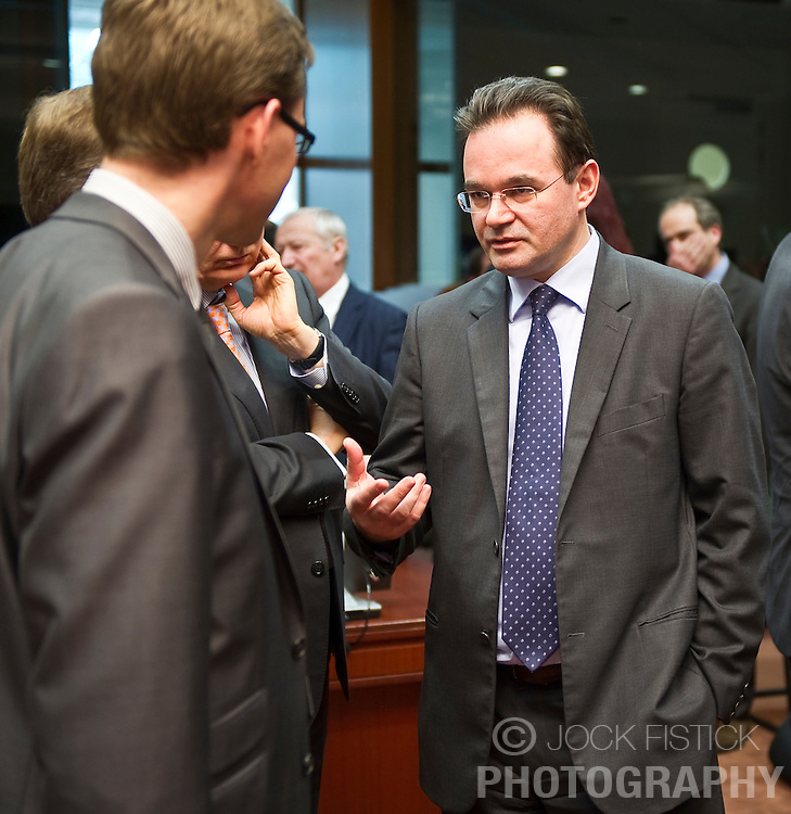George Papaconstantinou, Greece's finance minister, right, speaks with Jyrki Katainen, Finland's finance minister, during the emergency meeting of European Union finance ministers in Brussels, Belgium, on Sunday, May 9, 2010.  European Union finance ministers meet today to hammer out the details of an emergency fund to prevent a sovereign debt crisis from shattering confidence in the 11-year-old euro. (Photo © Jock Fistick).
