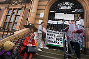 Poetry recital from local campaigners protesting on the steps of Carnegie Library in Herne Hill, south London while occupiers remain inside the premises on day 5 of its occupation, 4th April 2016. The angry local community in the south London borough have occupied their important resource for learning and social hub for the weekend. After a long campaign by locals, Lambeth have gone ahead and closed the library's doors for the last time because they say, cuts to their budget mean millions must be saved. A gym will replace the working library and while some of the 20,000 books on shelves will remain, no librarians will be present to administer it.