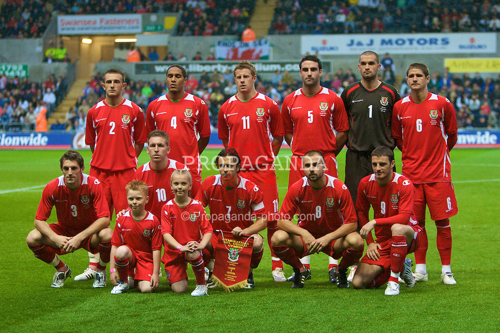 SWANSEA, WALES - Wednesday, August 20, 2008: Wales players line-up for a team group photograph before an international friendly match against Georgia at the Liberty Stadium. Back row L-R: Neal Eardley, Ashley Williams, Paul Parry, Craig Morgan, goalkeeper Boaz Myhill, Carl Robinson. Front row L-R: Sam Ricketts, Freddy Eastwood, captain Simon Davies, Carl Fletcher and Jason Koumas. (Photo by Chris Ratcliffe/Propaganda)