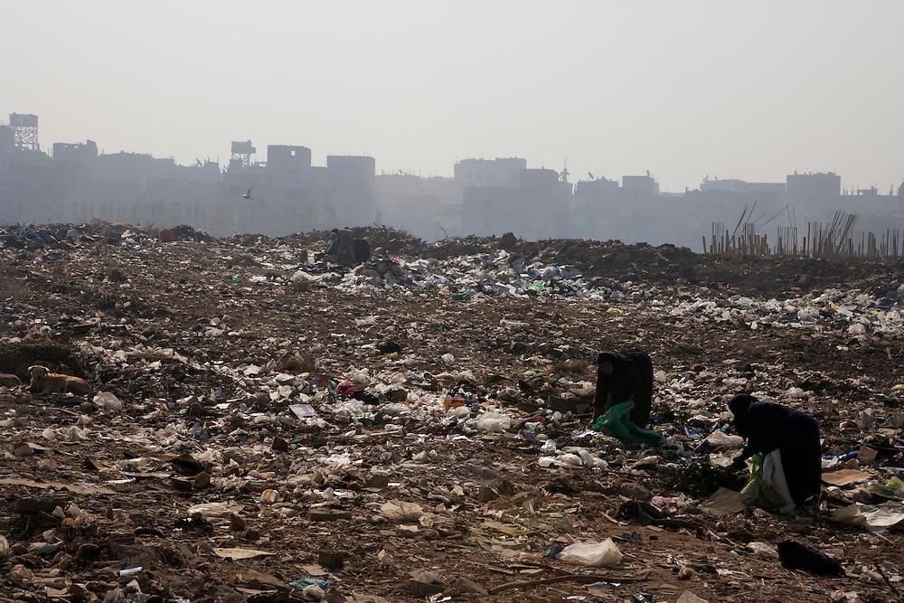Women scavenge in the garbage in an illegal (unplanned) garbage dump. .Cairo, Egypt.
