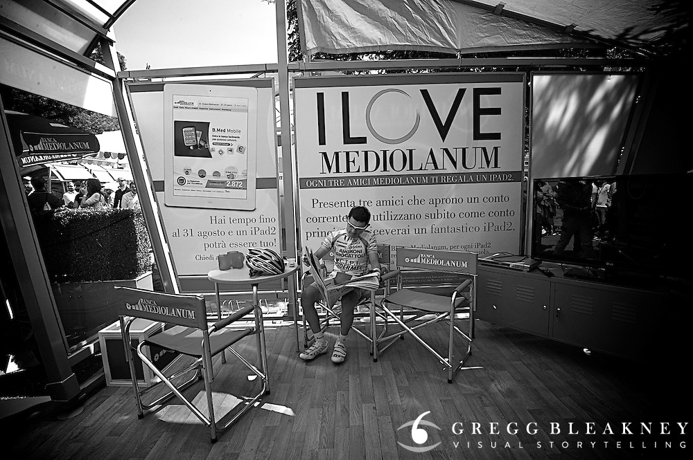 Jose Rujano seems to seek out quit spaces in the minutes before start time.  Here, he relaxes with the morning paper in one of the Giro's few empty media tents. 2011 Giro d' Italia Stage 3
