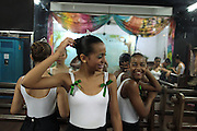 Girls laugh as they wait for their ballet class to start at the 'Ballet Santa Teresa' academy in Rio de Janeiro August 13, 2012.'Ballet Santa Teresa', a non-governmental organization (NGO) gives children who live in areas with social risk, some suffering domestic violence, free ballet classes and other activities as a part of socio-cultural integration project. Photo by: Pilar Olivares