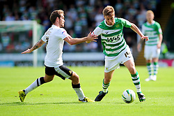 Yeovil Town's Sam Foley attempts to brush aside Doncaster Rovers' Martin Woods - Photo mandatory by-line: Dougie Allward/Josephmeredith.com  - Tel: Mobile:07966 386802 01/09/2012 - SPORT - FOOTBALL - League 1 -  Yeovil  - Huish Park -  Yeovil Town v Doncaster Rovers