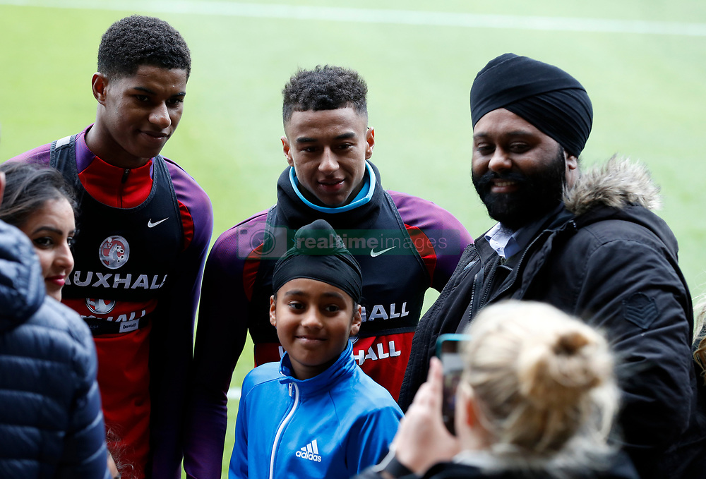 England's Marcus Rashford and Jesse Lingard pose for a photo during the training session at St George's Park, Burton.