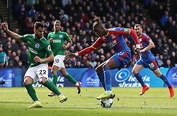 Brighton & Hove Albion's Martin Montoya (left) and Crystal Palace's Wilfried Zaha battle for the ball
