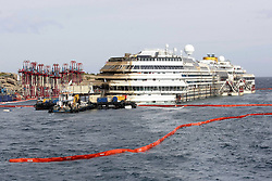 60490197<br /> Isola del Giglio, Italy. <br /> A view of the wreck of Italy's Costa Concordia cruise ship after it emerged from the water on September 17, 2013, near the harbour of Giglio Porto. On 13 January 2012, she was wrecked off the coast of Isola del Giglio in Italy. She has been declared a total loss and is being salvaged as of 2013, following which she will be scrapped, Italy, Tuesday September 17, 2013,<br /> Picture by imago / i-Images<br /> UK ONLY