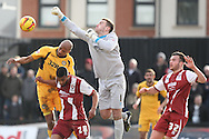 Cheltenham Town goalkeeper Scott Brown punches clear. Skybet football league 2 match, Newport county v Cheltenham Town at Rodney Parade in Newport, South Wales on Saturday 22nd Feb 2014.<br /> pic by Mark Hawkins, Andrew Orchard sports photography.