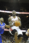 Jan 31, 2010; Cleveland, OH, USA; Los Angeles Clippers forward Marcus Camby (23) tries to block Cleveland Cavaliers forward LeBron James (23) during the first quarter at Quicken Loans Arena. Mandatory Credit: Jason Miller-US PRESSWIRE