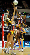 Remalda Aiken reaches for the ball during action from the Major Semi Final of the ANZ Netball Championship played between the Firebirds and the Magic at the Gold Coast Convention and Exhibition Centre on Monday 9th May 2011